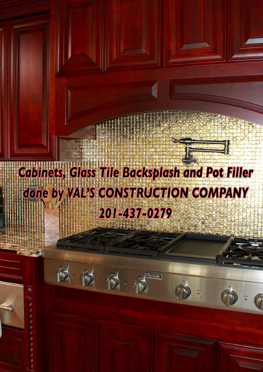 CABINETS BACKSPLASH AND POT FILLER DONE BY VAL'S CONSTRUCTION COMPANY